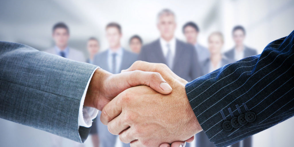 42323560 - composite image of business people shaking hands
